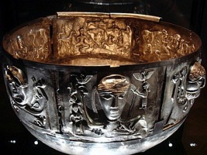 The Gundestrup cauldron is a richly decorated silver vessel, thought to date between 200 BC and 300 AD. It  is the largest known example of European Iron Age silver work  It was found in 1891 in a peat bog near the hamlet of Gundestrup, Denmark